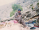 Iraq 1990 .A physician in the mountains near Sengaw, writing his memories  during a rest .Irak 1990 .Medecin dans les montagnes pres de Sengaw ecrivant ses memoires pendant le repos