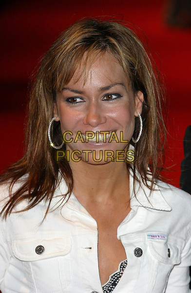 TARA PALMER TOMKINSON.Daily Mirror Pride Of Britain Awards, London Hilton Hotel, Park Lane.15th March 2004.headshot, portrait, hoop earrings, sass & bide top.www.capitalpictures.com.sales@capitalpictures.com.©Capital Pictures