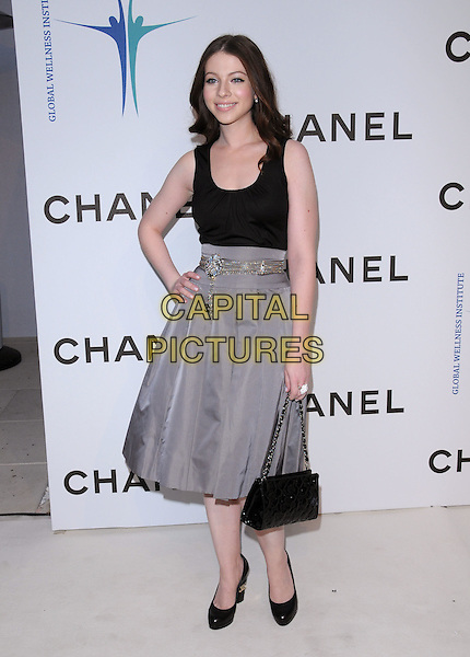 MICHELLE TRACHTENBERG .at The Chanel Boutique Opening on Robertson Blvd. in Beverly Hills, California, USA, May 29 2008..full length black top grey gray skirt hand on hip bag shoes belt quilted .CAP/DVS.©Debbie VanStory/Capital Pictures