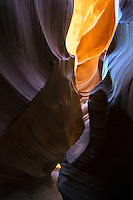 Narrow hiking paths amongst the eroded sandstone scultures in the Antelope slot canyon on the Colorado Plateau near Lake Powell in Arizona