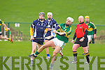Kerry's Darragh O'Connell and IT Tralee's Colum Harty in action in the Waterford Crystal Cup at Abbeydorney on Sunday..