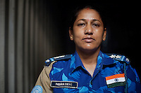 MEera Devi, 40 years old, Sub inspector from Emachal Pradesh State, An Indian female Peacekeeper from the Indian FPU ( formed police unit ) during a break in her compound in Monrovia, Liberia on Wednesday March 21 2007. .103 Indian police personnel  were specially selected to take part in the UNMIL peacekeeping mission in Liberia for an initial deployment of 6 months. .They are the first contingent entirely formed by women in the history of the United Nations Peacekeeping..their mission in the country is to provide fire support to the unarmed liberian security forces. In india these women distinguished themselves by operating in the most troubled areas of the country taking part in counter insurgency and crowd control special operations.
