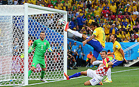 Neymar of Brazil stretches but can't quite score an equalising goal at 0-1