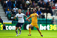 Preston North End's Tom Clarke  competes with Wigan Athletic's Will Grigg<br /> <br /> Photographer Richard Martin-Roberts/CameraSport<br /> <br /> The EFL Sky Bet Championship - Preston North End v Wigan Athletic - Saturday 6th October 2018 - Deepdale Stadium - Preston<br /> <br /> World Copyright &copy; 2018 CameraSport. All rights reserved. 43 Linden Ave. Countesthorpe. Leicester. England. LE8 5PG - Tel: +44 (0) 116 277 4147 - admin@camerasport.com - www.camerasport.com