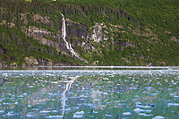 Waterfall flows out of the Chugach mountains, Chugach National Forest, Barry Arm, Prince William Sound, southcentral, Alaska.