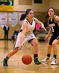 Manogue's Hanna Bingham drives past Galena defender Olivia Anderson at Manogue High School in Reno, Nev., on Tuesday, Feb. 11, 2014. Manogue won 51-29.<br /> Photo by Cathleen Allison
