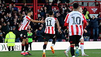 Ollie Watkins of Brentford runs towards the home fans to celebrate scoring their third goal during Brentford vs Middlesbrough, Sky Bet EFL Championship Football at Griffin Park on 8th February 2020