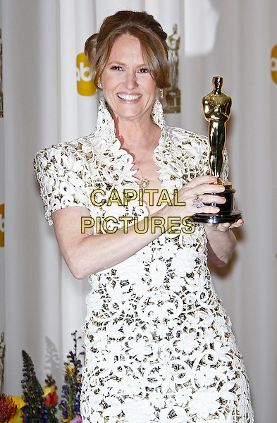 MELISSA LEO.Best Actress in a Supporting Role.83rd Annual Academy Awards - Oscars.Kodak Theatre, Hollywood, CA, USA..February 27th, 2011 .Pressroom press room winner trophy half length shoulder pads dress white lace high collar  .CAP/PE.©Peter Eden/Capital Pictures.