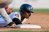 Connecticut Tigers second baseman Jeremiah Burks (28) dives back to first base on a pick off attempt during a game against the Lowell Spinners on August 26, 2018 at Dodd Stadium in Norwich, Connecticut.  Connecticut defeated Lowell 11-3.  (Mike Janes/Four Seam Images)