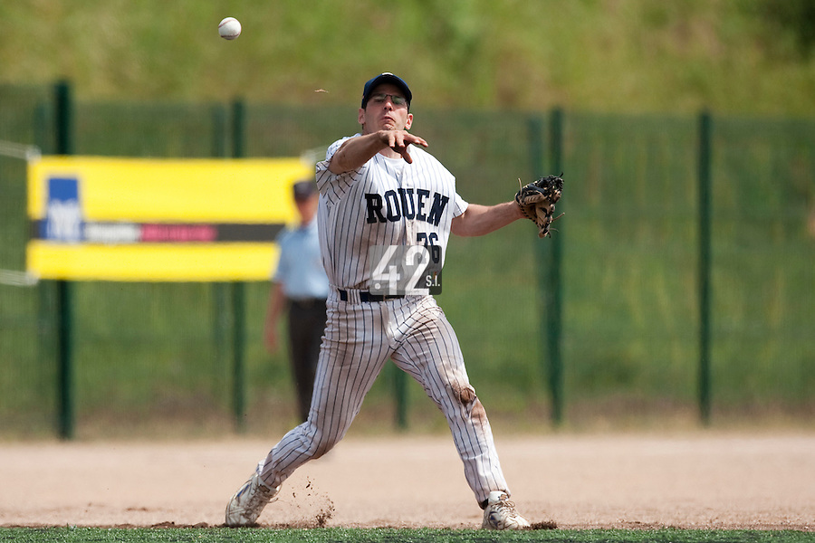 23 May 2009: Olivier Israel of Rouen throws the ball to first base during the 2009 challenge de France, a tournament with the best French baseball teams - all eight elite league clubs - to determine a spot in the European Cup next year, at Montpellier, France. Rouen wins 6-2 over La Guerche.