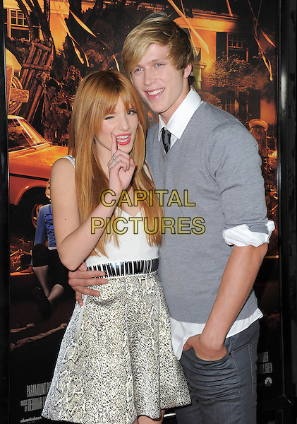 "Bella Thorne, Tristan Klier.""Fun Size"" Los Angeles Premiere held at Paramount Studios, Los Angeles, California, USA..October 25th, 2012.half length grey gray jumper sweater couple white top arm around waist mouth open hand finger  wink winking eye closed .CAP/RKE/DVS.©DVS/RockinExposures/Capital Pictures"
