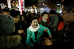 Tokyo, December 11 2012 - General election campaign by Mirai no To (Japan future party) leader Mrs Yukiko Kada (green jacket) supporting the independant candidate Taro Yamamoto in front of Asagaya station, Suginami ward.