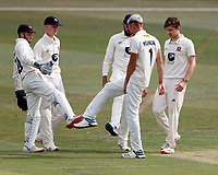 Harry Podmore of Kent plays footsie with teammates after taking the wicket of Delray Rawlins during Kent CCC vs Sussex CCC, Bob Willis Trophy Cricket at The Spitfire Ground on 8th August 2020