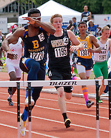John Burroughs High School senior Ezekiel Elliott heads over the final hurdle on his way to victory in the Class 3 Boys 300 meter Hurdle final while Cassville's Cody Frana (1195) chases, on his way to a runner-up finish. Elliott finished in 39.01 while Frana finished in 39.66.