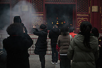 Chinese New Year( Spring festival) 2014, Lamas Temple (Yonghegong) in Beijing. Believers are  offering incense and prayers the firtst day of the Lunar Year of the Horse in order to gain luck and prosperity ,January 31 2014.