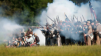 NWA Democrat-Gazette/BEN GOFF @NWABENGOFF<br /> Confederate States of America soldiers fire a volley on Friday Sept. 25, 2015 during the Battle of Pea Ridge Civil War reenactment at Webb Farm near Pea Ridge. The event continues with battle reenactments at 2:00p.m. on Saturday and at 11:00a.m. Sunday.
