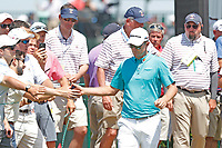 Justin Rose (ENG) high fives fans as he walks to the first tee during the third round of the 118th U.S. Open Championship at Shinnecock Hills Golf Club in Southampton, NY, USA. 16th June 2018.<br /> Picture: Golffile | Brian Spurlock<br /> <br /> <br /> All photo usage must carry mandatory copyright credit (&copy; Golffile | Brian Spurlock)