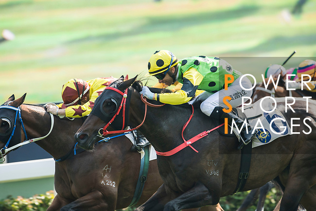 Jockey Umberto Rispoli riding Southern Legend #9 defeats Nothingilikemore #6 ridden by jockey Joao Moreira the Race 3, Flying Dancer Handicap, during the Longines Hong Kong International Races at Sha Tin Racecourse on December 10 2017, in Hong Kong, Hong Kong. Photo by Victor Fraile / Power Sport Images