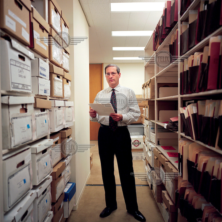 Michael Goldberg, a lawyer with Baker Botts in Houston, Texas. Goldberg has taken on the case of Linda Carty, a British citizen on death row in Texas. Goldberg stands between Linda's case files. Linda's original defence lawyer only spent one hour with her before the beginning of the trial..