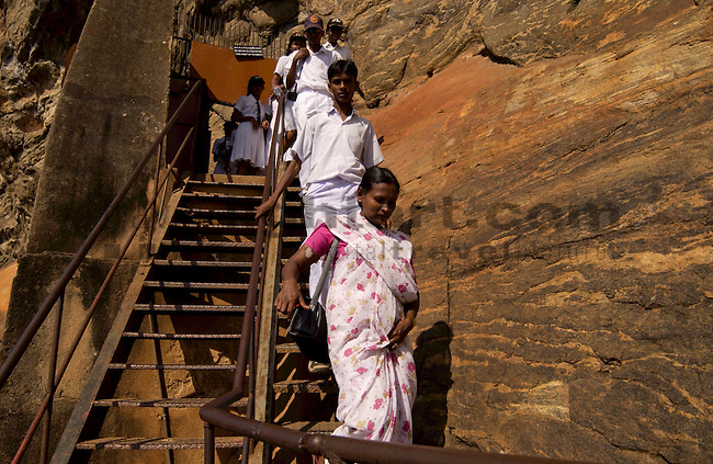 SIGIRYA ROCK FORTRESS, MATALE DISTRICT, CENTRAL PROVINCE, SRI LANKA...LION-ROCK, HISTORICAL-SITE, UNESCO WORLD HERITAGE, WAY, PATH, MONOLITH, STAIRS, PEOPLE, VISITORS, TOURISTS, WOMEN, ..©Photo: Paul J.Trummer, Mauren / Liechtenstein www.travel-lightart.com
