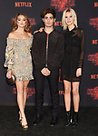 WESTWOOD, CA - OCTOBER 26: (L-R) Actors Paris Berelc, Emery Kelly and Isabel May arrive at the Premiere Of Netflix's 'Stranger Things' Season 2 at Regency Westwood Village Theatre on October 26, 2017 in Los Angeles, California.