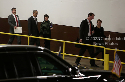 United States President Barack Obama(2nd left) and adviser Valerie Jarrett (3rd left) walk to the presidential limousine May 8, 2013 after he spoke to electric utility officers about lessons learned from Hurricane Sandy at the Department of Energy in Washington, DC. <br /> Credit: Chris Kleponis / Pool via CNP