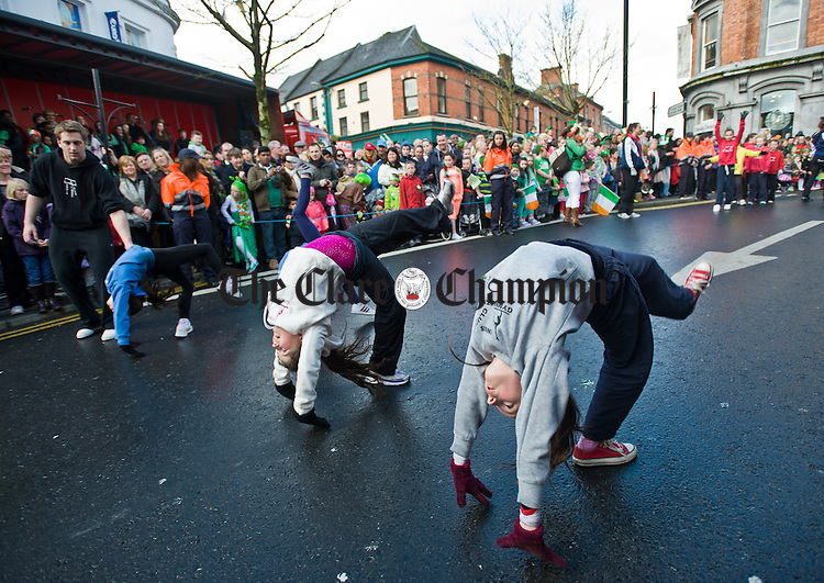 Members of Ennis Gymnastics club in action during the St Patrick's Day parade at Ennis. Photograph by John Kelly.