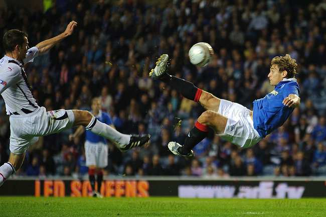 Nikica Jelavic scores his second goal with a stunning overhead kick