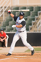 Right fielder Christian Marrero (24) of the Kannapolis Intimidators follows through on his swing at Fieldcrest Cannon Stadium in Kannapolis, NC, Sunday August 10, 2008. (Photo by Brian Westerholt / Four Seam Images)