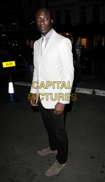 OZWALD BOATENG.Nicky Haslam's book launch party, Westbury Hotel, London, England. .April 21st, 2010 .full length black white suit jacket blazer jeans denim grey gray shoes loafers boateng.CAP/CAN.©Can Nguyen/Capital Pictures.