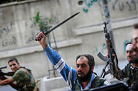 Photographer: Rick Findler..07.10.12 Members of the Free Syrian Army shout anti-Assad chants in the city of Aleppo, Syria. Heavy fighting continues in the city between the FSA and President Assad's forces.