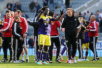Pictured: Swansea head coach Garry Monk (R) takes to the pitch to congratulate double scorer Wilfried Bony after the final whistle. Saturday 19 April 2014<br /> Re: Barclay's Premier League, Newcastle United v Swansea City FC at St James Park, Newcastle, UK.