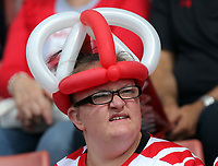 A Southampton supporter with a hat made out of balloons during the Premier League match between Southampton and Swansea City at the St Mary's Stadium, Southampton, England, UK. Saturday 12 August 2017