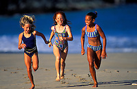 Three girls running on the beach, Big Island