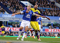 Pictured: Ashley Williams of Swansea (R) against Leon Osman of Everton. Sunday 16 February 2014<br />