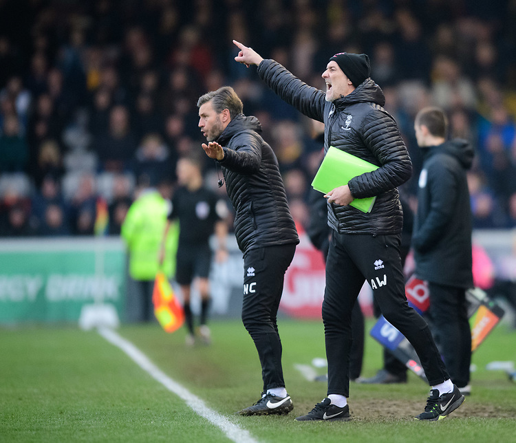 Lincoln City's assistant manager Nicky Cowley, left, and Lincoln City's first team goalkeeping coach Andy Warrington shout instructions to their team from the technical area<br /> <br /> Photographer Chris Vaughan/CameraSport<br /> <br /> The EFL Sky Bet League Two - Lincoln City v Mansfield Town - Saturday 24th November 2018 - Sincil Bank - Lincoln<br /> <br /> World Copyright © 2018 CameraSport. All rights reserved. 43 Linden Ave. Countesthorpe. Leicester. England. LE8 5PG - Tel: +44 (0) 116 277 4147 - admin@camerasport.com - www.camerasport.com