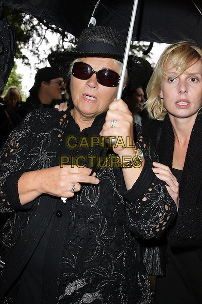 PAM ST. CLEMENT.Funeral of actor and comedian Mike Reid at Little Easton Church, Great Dunmow, Essex, England, .August 14th 2007..half length Eastenders co-star black hat sunglasses holding umbrella raining death.CAP/ROS.©Steve Ross/Capital Pictures