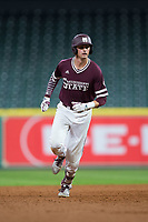 Tanner Poole (12) of the Mississippi State Bulldogs rounds the bases after hitting a go-ahead home run in the top of the ninth inning against the Louisiana-Lafayette Ragin' Cajuns in game three of the 2018 Shriners Hospitals for Children College Classic at Minute Maid Park on March 2, 2018 in Houston, Texas.  The Bulldogs defeated the Ragin' Cajuns 3-1.   (Brian Westerholt/Four Seam Images)