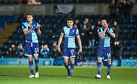 (l-r) Will De Havilland, Luke O'Nien & Michael Harriman of Wycombe Wanderers applauds the support after the Sky Bet League 2 match between Wycombe Wanderers and Plymouth Argyle at Adams Park, High Wycombe, England on 14 March 2017. Photo by Kevin Prescod / PRiME Media Images.