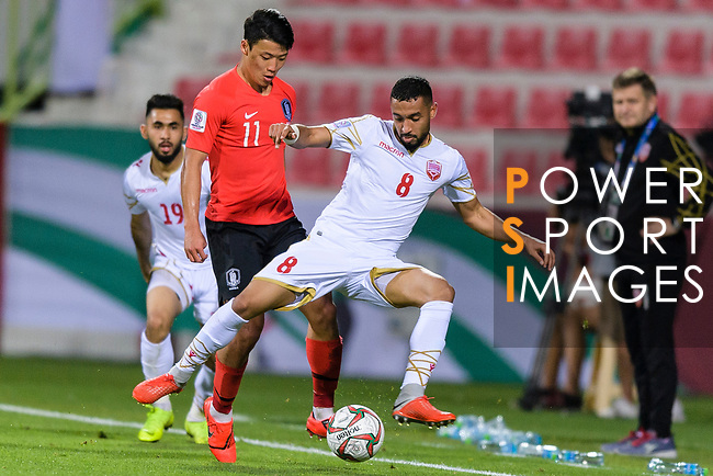 Hwang Heechan of South Korea (L) fights for the ball with Mohamed Jasim Marhoon of Bahrain (R) during the AFC Asian Cup UAE 2019 Round of 16 match between South Korea (KOR) and Bahrain (BHR) at Rashid Stadium on 22 January 2019 in Dubai, United Arab Emirates. Photo by Marcio Rodrigo Machado / Power Sport Images