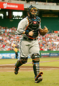 Washington, D.C. - August 11, 2006 -- New York Mets catcher Paul Lo Duca (16) returns to the dugout after first inning action against the Washington Nationals at RFK Stadium in Washington, D.C. on Friday, August 11, 2006.  In honor of Negro Leagues Appreciation Night, the teams are wearing the uniforms of the Homestead Grays (Nationals) and New York Cubans (Mets). The Nationals won the game 2 - 1.<br /> Credit: Ron Sachs / CNP<br /> (RESTRICTION: No New York Metro or other Newspapers within a 75 mile radius of New York City)