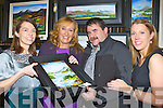 Olivia Flynn, Phil O'Grady, William Sheahan and Michelle O'Donoghue Killarney admiring the paintings at the Killarney Lions club Wine and Art exhibition in the Malton Hotel on Thursday night..