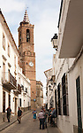 Church of Our Lady of the Assumption and people in village street, Aroche, Sierra de Aracena, Huelva province, Spain