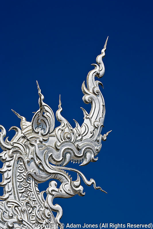 Rooftop architectural detail of dragon head on the new all white temple of Wat Rong Khun in Tambon Pa-Or Donchai designed by Chalemchai Kositpipat.