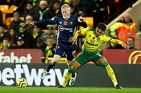 8th November 2019; Carrow Road, Norwich, Norfolk, England, English Premier League Football, Norwich versus Watford; Max Aaron of Norwich City fouls Will Hughes of Watford - Strictly Editorial Use Only. No use with unauthorized audio, video, data, fixture lists, club/league logos or 'live' services. Online in-match use limited to 120 images, no video emulation. No use in betting, games or single club/league/player publications
