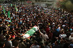 Palestinian mourners carry the body of Mohammed al-Radee, 25, who was killed in Israeli tank fire during his funeral, in Beit Lahia in the northern of Gaza Strip on May 28, 2018. Photo by Dawoud Abo Alkas