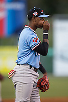 Hickory Crawdads third baseman Ti'Quan Forbes (10) blows on his hand on a chilly night during the game against the Kannapolis Intimidators at Kannapolis Intimidators Stadium on April 9, 2016 in Kannapolis, North Carolina.  The Crawdads defeated the Intimidators 6-1 in 10 innings.  (Brian Westerholt/Four Seam Images)