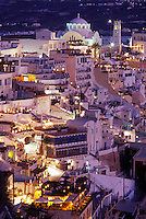Santorini, Greek Islands, Fira, Cyclades, Greece, Europe, Village of Fira on the steep hillside of Santorini Island in the evening on the Aegean Sea.