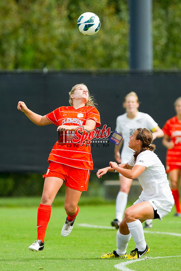 Kylie Tawney (17) of the Clemson Tigers heads the ball away from Jackie McSally (6) of the Wake Forest Demon Deacons at Spry Soccer Stadium on September 30, 2012 in Winston-Salem, North Carolina.  The Demon Deacons defeated the Tigers 4-0.  (Brian Westerholt/Sports On Film)