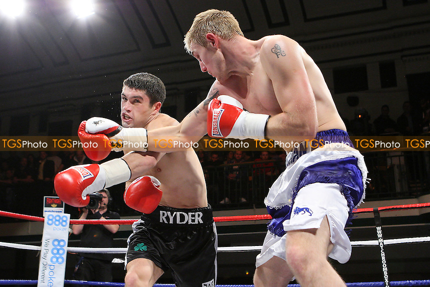 John Ryder (black shorts) defeats Luke Osman in a Middleweight boxing contest at York Hall, Bethnal Green, promoted by Matchroom Sports - 09/11/11 - MANDATORY CREDIT: Gavin Ellis/TGSPHOTO - Self billing applies where appropriate - 0845 094 6026 - contact@tgsphoto.co.uk - NO UNPAID USE.